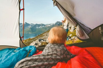 Foto op Canvas Kamperen Child in camping tent enjoying mountains view family vacation adventure lifestyle child hiking with parents outdoor