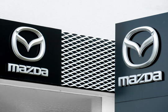 MAZDA dealership sign on a facade. Mazda Motor Corporation is a famous Japanese automotive manufacturer