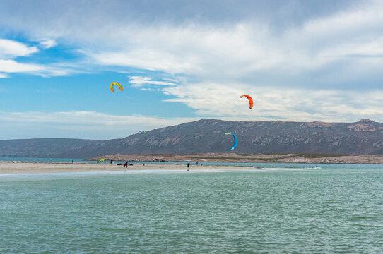 People kite surfing in Langebaan seaside town in South Africa