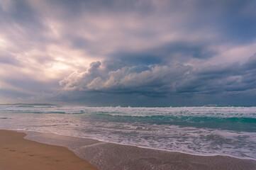Sunrise beach landscape with sand coastline and soft waves