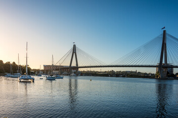 Sydney cityscape with harbor view, ANZAC bridge and boats