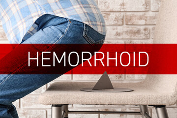 Autocollant pour porte Ane Woman sitting down on chair with thumbtack. Hemorrhoids concept