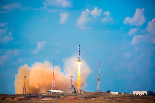 Take-off of a real launch vehicle from a spaceport. A rocket takes off into the sky against a background of clouds. Startup concept, power of science and technology. Modern technology