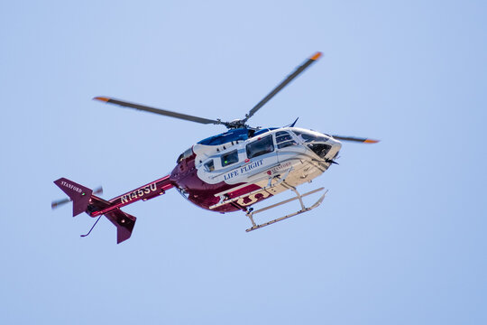 May 15, 2020 Palo Alto / CA / USA - Stanford Health Care Life Flight Helicopter in mid flight; The Stanford Life Flight program began 1984 and uses an EC 145 helicopter