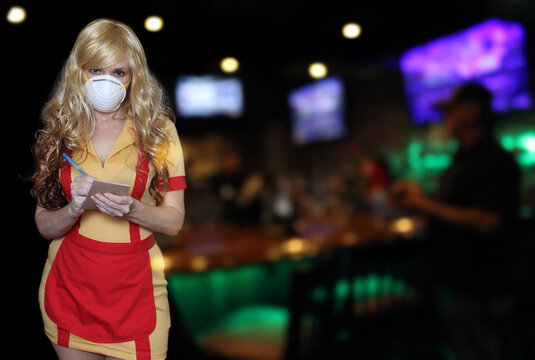 Waitress Wearing N95 Mask With Blurred Restaurant Background
