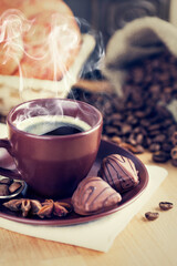 Tuinposter Cup coffee with beans and chocolate candies. Stock photo. Stock photo.