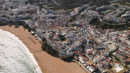 Wall Mural - Aerial view of the beach, cliffs and white architecture of Albufeira, Portugal