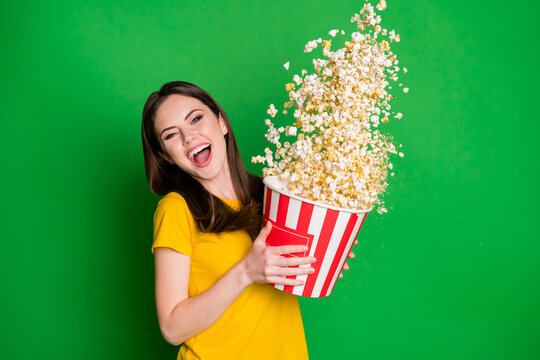 Portrait of her she nice-looking attractive pretty lovely cheerful cheery straight-haired girl eating throwing corn having fun isolated on bright vivid shine vibrant green color background