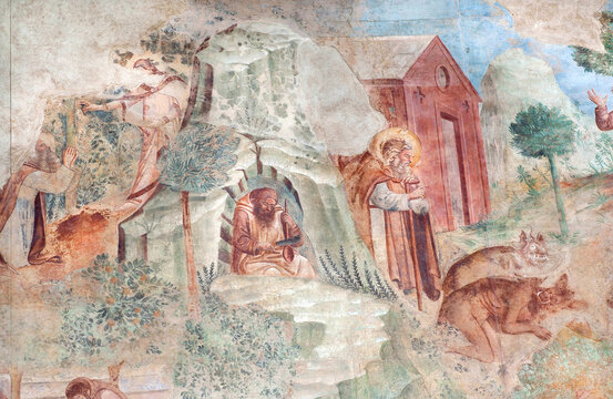 Saints and devils on 14th century fresco Triumph of Death and Last Judgement in Camposanto Monumentale. Pisa of Italy.
