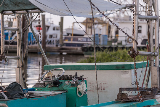 Interior of shrimp fishing boat docked on shore in southern bayou of Louisiana