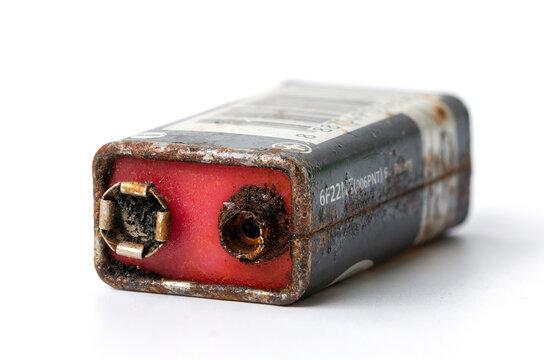 Old battery 9V leak isolated / Hazardous waste concept,on white  isolated background.