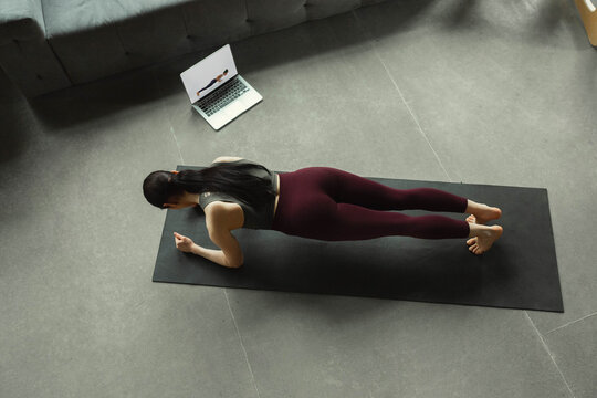 Meditation. Sporty beautiful young woman taking professional yoga lessons online and practice at home. Concept of healthy lifestyle, wellness, wellbeing, looking for new hobby. Flexible and motivated.