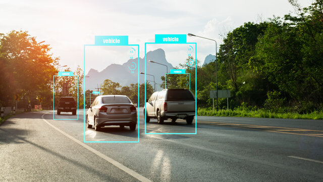 Artificial intelligence concept.Software ui analytics and recognition vehicles in road with flare light effect.Machine learning analytics identify vehicles technology.