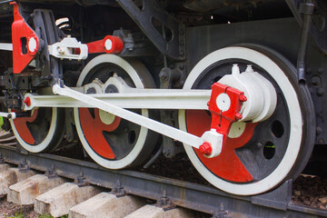Wheels of an old steam locomotive. An old steam locomotive. Red locomotive wheels.