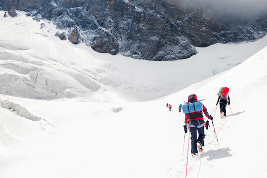 Group of alpinists reach the Everest summit in Nepal. Team work concept.
