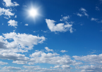 Wall Mural - Blue sky with clouds and sun.
