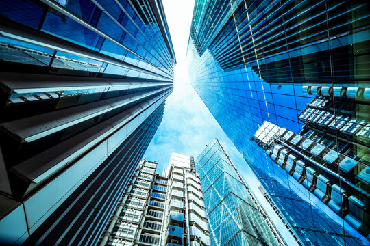 Looking up perspective of financial buildings. Financial business concept