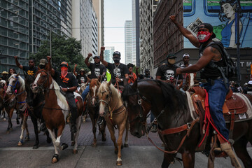 Protesters on horseback rally against death in Minneapolis police custody of George Floyd, in Houston