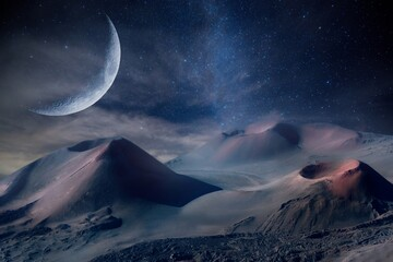 Beautiful scenery of volcanoes under the surreal moon at night time