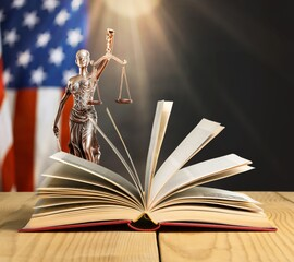 Wall Mural - Old open book on a justice lady statue  background
