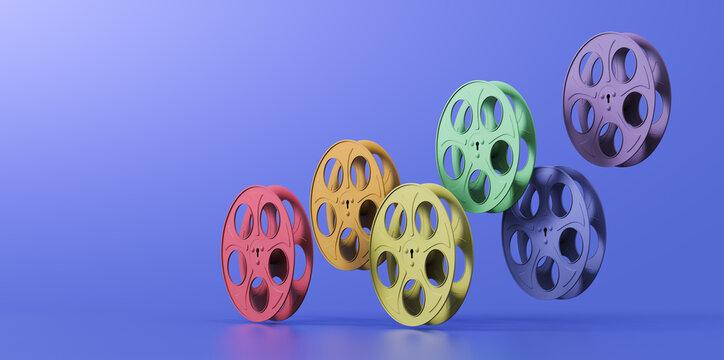 3D illustration of film reels arranged in a rainbow hue