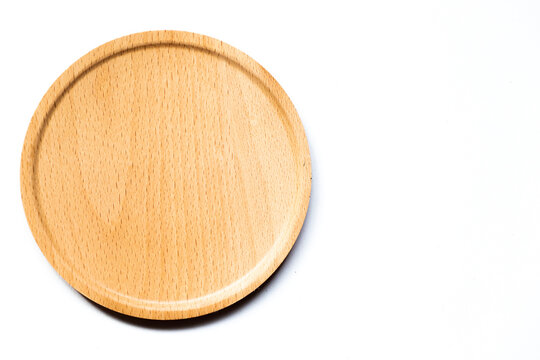 Top view of round wood tray on white background with copy space