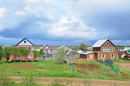 Kola Peninsula, Russia. Old Pomeranian village of Varzuga in cloudy summer day