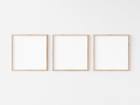 Three square thin wooden frame on white wall. 3d illustration.