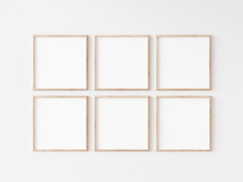 Six square thin wooden frame on white wall. 3d illustration.