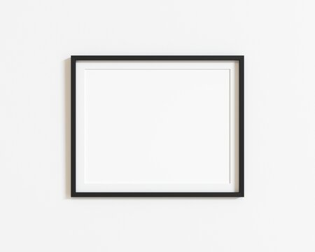 Black horizontal frame mockup on white wall. Landscape frame. 3d illustration.