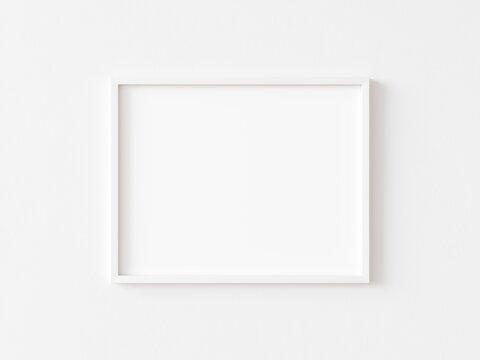 Horizontal white frame mockup on white wall. 3d illustration.