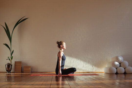 Woman sitting in lotus position meditating