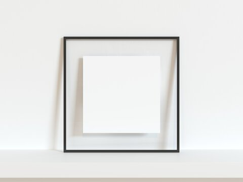 Square black thin empty frame mock up on white wall. 3d illustration.
