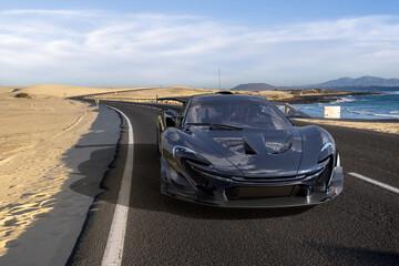 """McLaren P1 GTR, McLaren racing """"hypercar"""" on a desert asphalt road"""