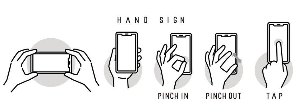 スマホを持つ手・操作するハンドサイン