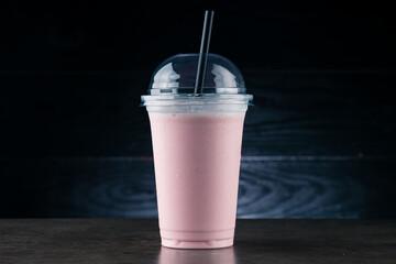 strawberry milkshake on a dark background