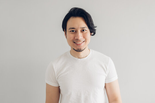 Happy smile face Asian man with long black hair and white t-shirt.
