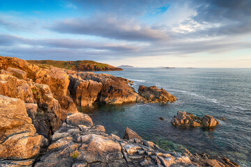 Wall Mural - Beautiful evening light over the rugged cliffs at Hushinish