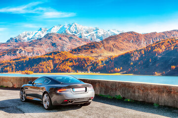 Awesome autumn scene near Maloja village and asphalt road on the shore of Sils lake(Silsersee). Wall mural
