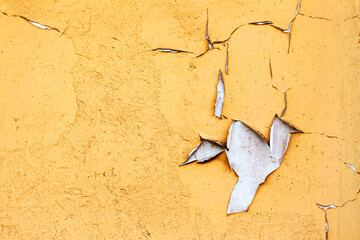 Creative beautiful bright yellow background, cracks and scratches on the concrete. Grungy concrete...