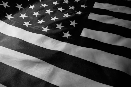 Black and white American flag. USA black pride revolution. Anti racism riots. Black out Tuesday. Black lives matter. Racial injustice awareness. United States mourning. Nation unity.