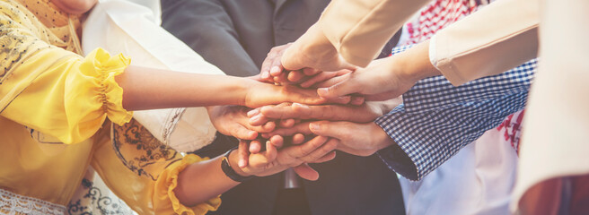 Group of people diversity multiethnic teamwork collaboration team meeting communication  Unified team concept. Business people hands together diversity multiethnic diverse culture partner team meeting - fototapety na wymiar