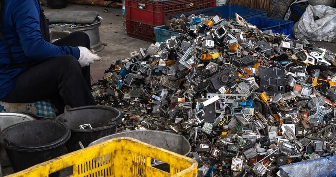 Scrap yard electronic waste for recycling with selective focus. electronic aluminium waste