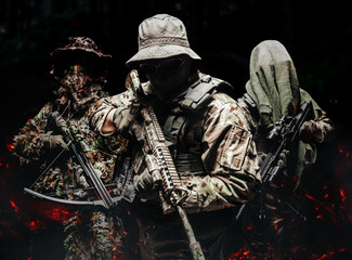 Camouflaged soldiers standing with weapons.