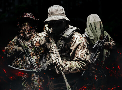 Shaded camouflaged soldiers in uniform standing with weapons.