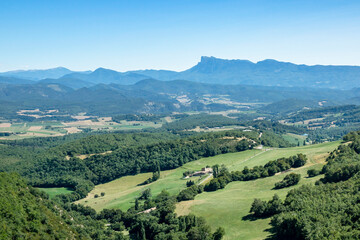 Panoramic view of the green tableland between cities of Valence and Crest in Drome region with Vercors mountains on a background.