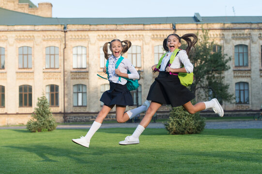 Happy last day of school. School children in high jump. School holidays. Energetic children in midair outdoors. Children wear. Summer vacation. Freedom. Children and youth. More joy and happiness