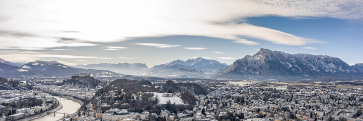 Fototapeten Alpen Panoramic aerial drone shot view of Salzburg aiglhof station with view of eastern bavarian alps mountain