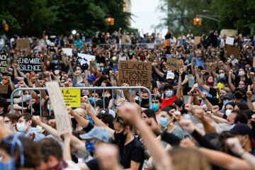 People hold a vigil near Gracie Mansion as protests against the death in Minneapolis police custody of George Floyd continue, in New York City