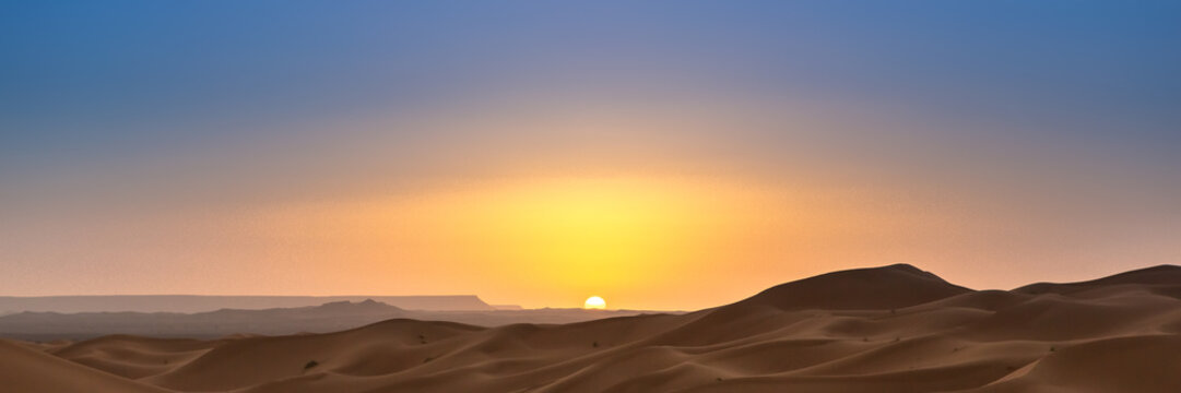 Merzouga in the Sahara Desert in Morocco. Web banner in panoramic view.